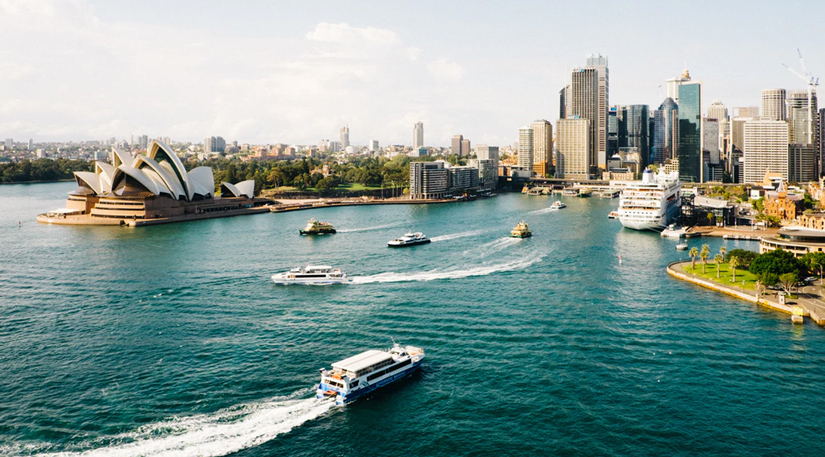 A drone shot of Sydney harbour and the opera house