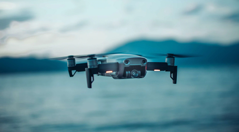 A drone flying above the sea