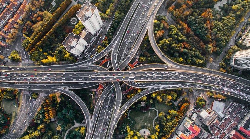 A drone shot of busy city roads