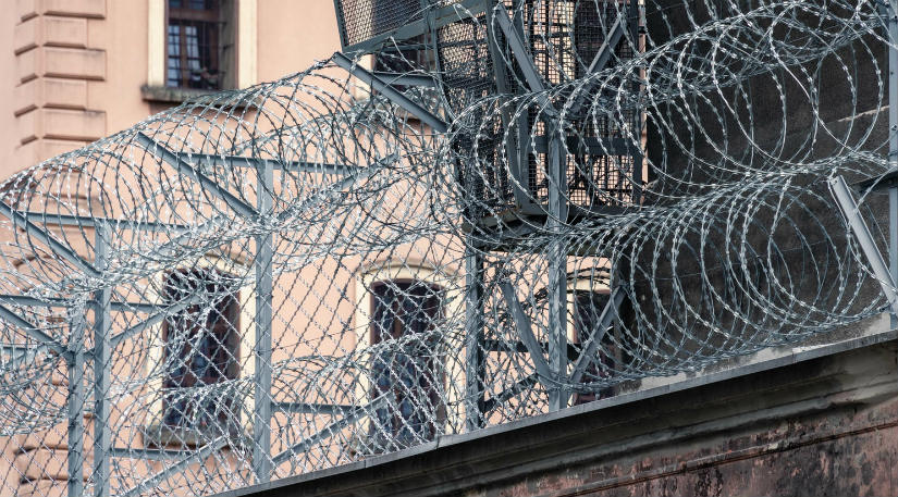 A prison with barbed wire