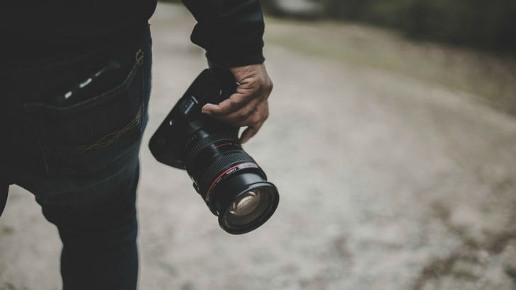A man with a DSLR camera